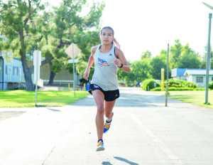 Angel Valdez, runs near the Student Recreation Center on Sept. 21. Valdez was named Western Athletic Conference Women's Cross-Country Athlete of The Week for Sept. 4-10. Photo by Simer Khurana/The Runner