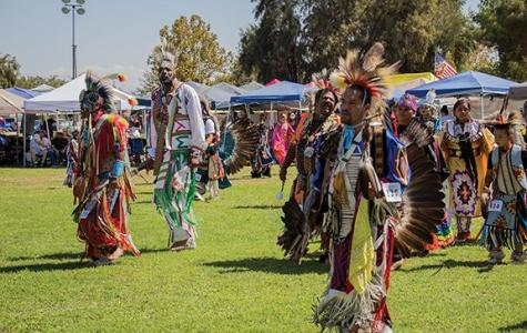 Photos by Skylar Carrasco/The Runner Different tribes, including the Tajon Tribe, Tule River Tribe, and Mississippi Band of Choctaw Tribe dance to the pounding of the drum circle at the CSUB campus.