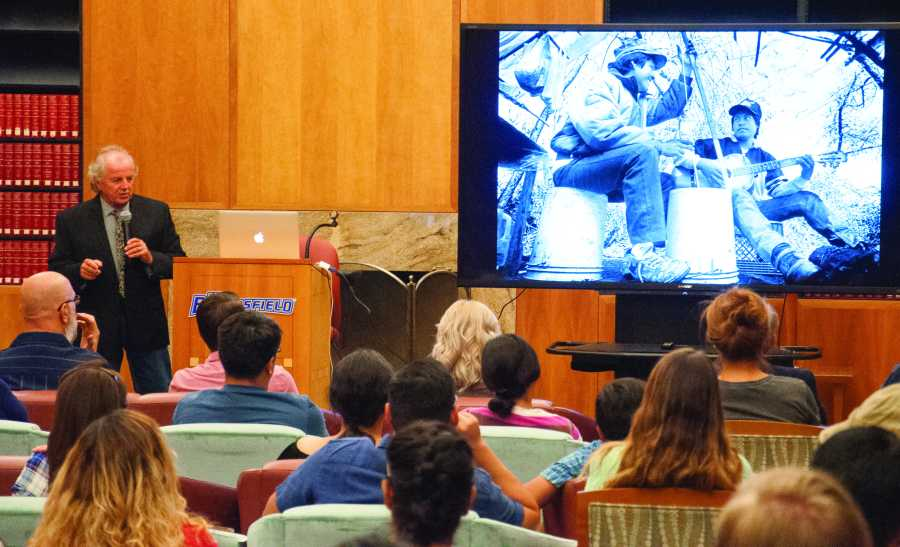 Pulitzer+Prize+winning+photojournalist+Don+Barletti+speaks+to+students+in+the+Dezember+rom+in+the+Walter+Stiern+Library+on+Oct.+10.+%0APhoto+by+Jarad+Mann%2F+The+Runner+
