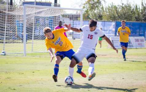 CSUB freshman defender Tanner Knorr battles for possession with UNLV junior midfielder Daniel Moran in a match on Sunday, Oct. 8 at the Main Soccer Field. The Roadrunners have won three straight games in conference play.  Photo by Simer Khurana/ The Runner