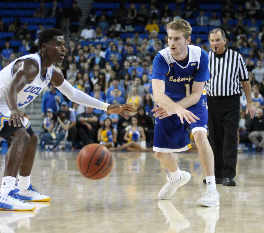 Brent Wrapp, a CSUB redshirt-senior guard, passes the ball to a teammate on Wednesday, Nov. 29 at Pauley Pavilion. CSUB lost 66-75 in their second-meeting ever. Photo by Peter Castillo/The Runner