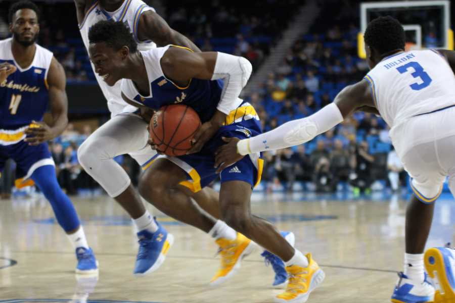 Freshman guard Jarkel Joiner slashes through a double team against UCLA defenders at Pauley Pavilion. Photo by Peter Castillo/ The Runner