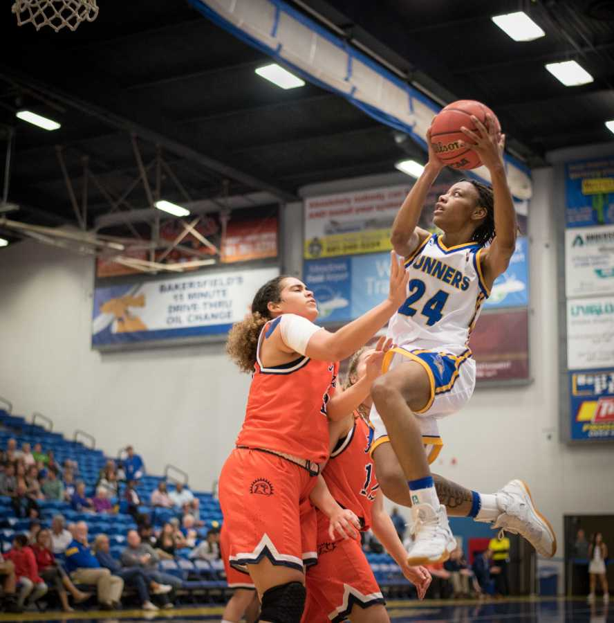 Senior forward Aja Williams puts up a shot in the paint against Fresno Pacific on Tuesday, Nov. 14 in the Icardo Center.