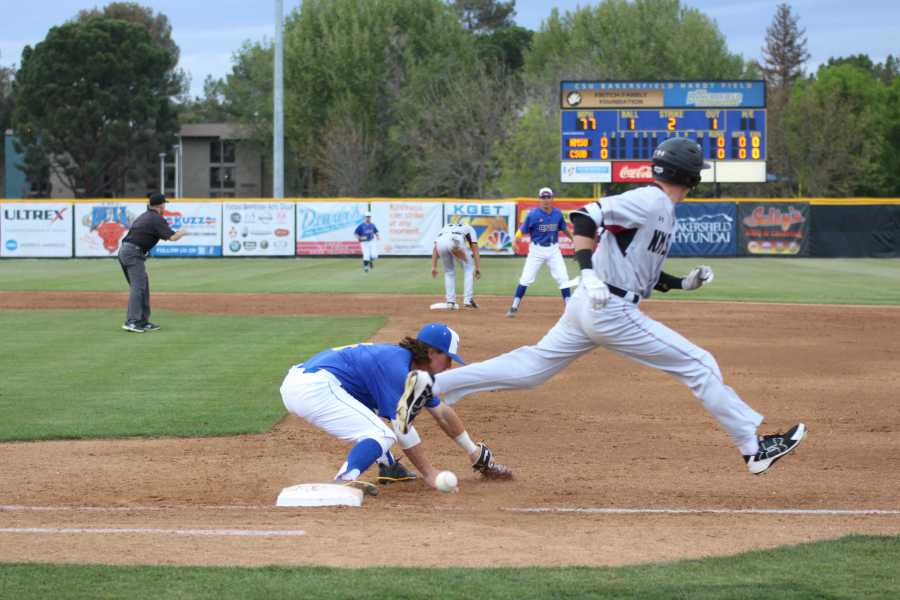 CSUB freshman shortstop overthrows  senior first baseman Andrew Penner  in the second inning, Friday, April 6 at Hardt Field.  Photo by Ricky Gonzales/ The Runner