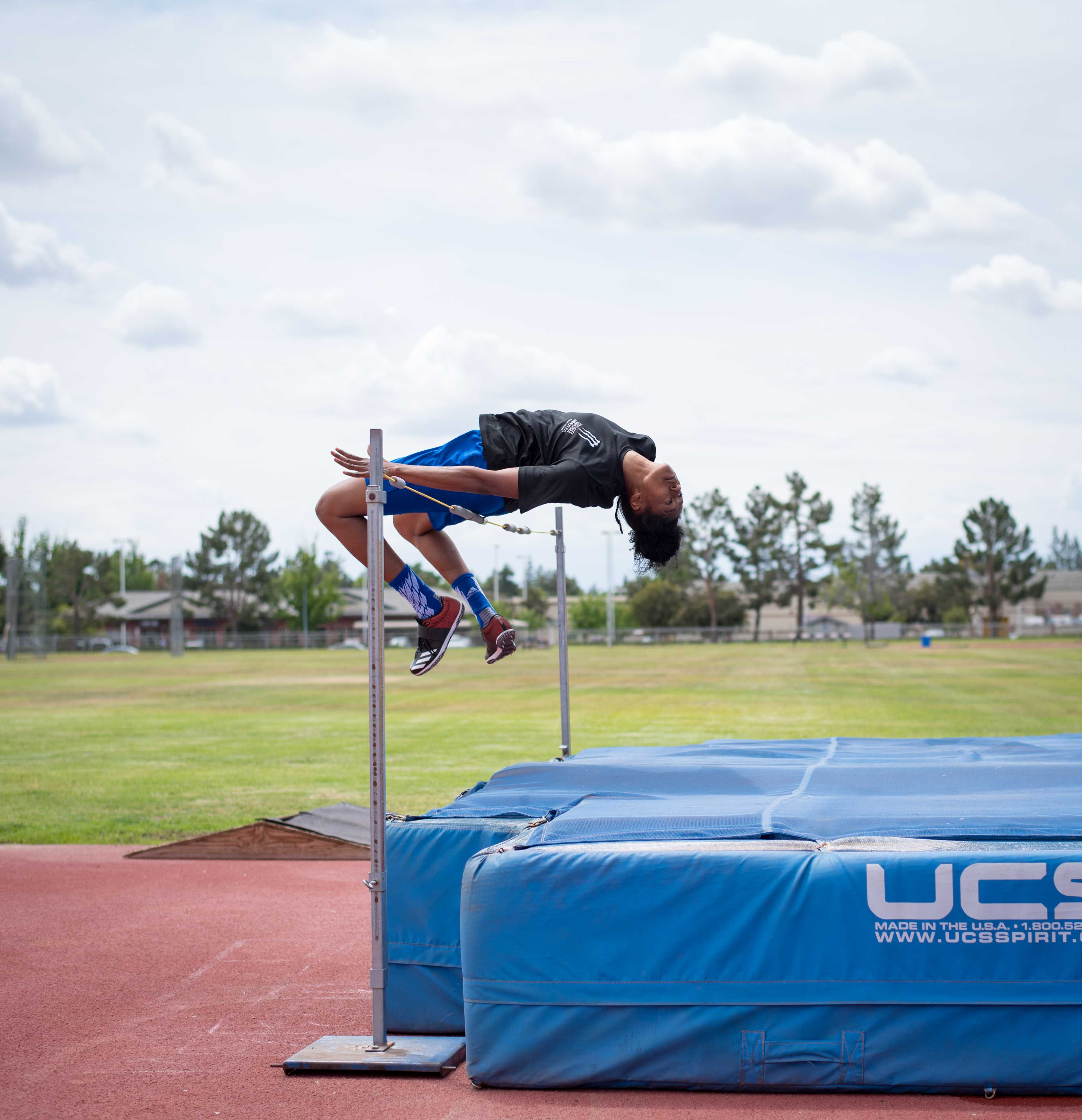 Senior Jazmyne Bartee practices April 30 her high jump in preperation for the Western Athletic Conference Outdoor Championships.  Photo by Simer Khurana/ The Runner