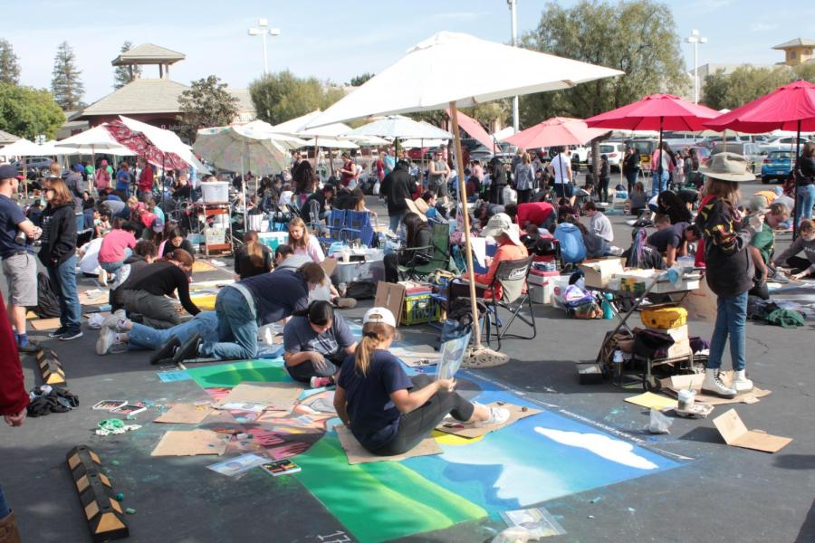 Local artists work on their art during Day 1  of Via Arté at the Market Place.