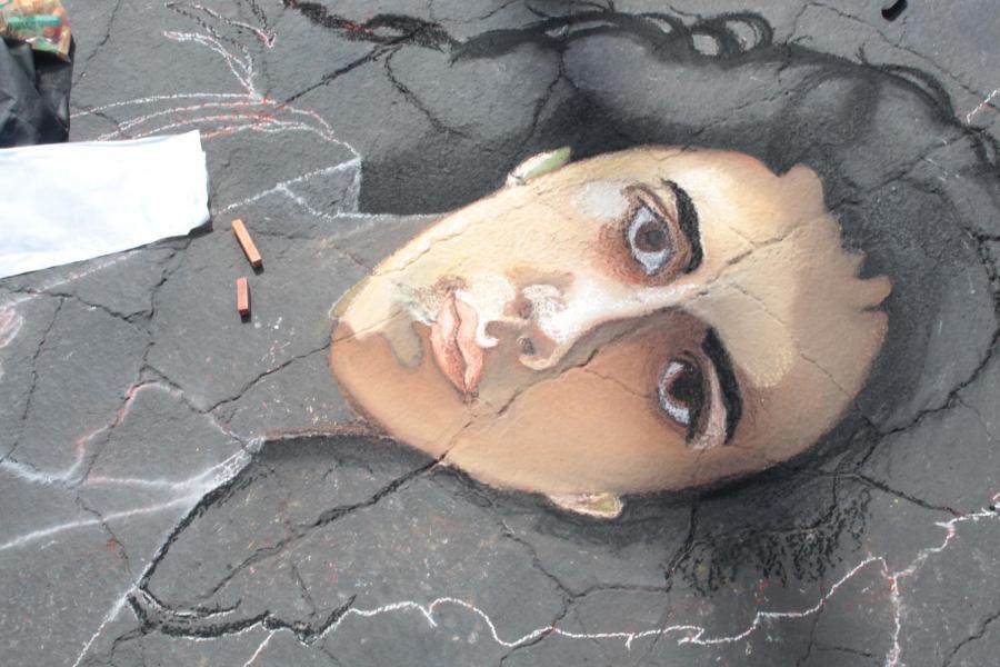 Magnolia Aviña, a senior studio arts major works on her piece on Day 1 of Via Arté at the Market Place.