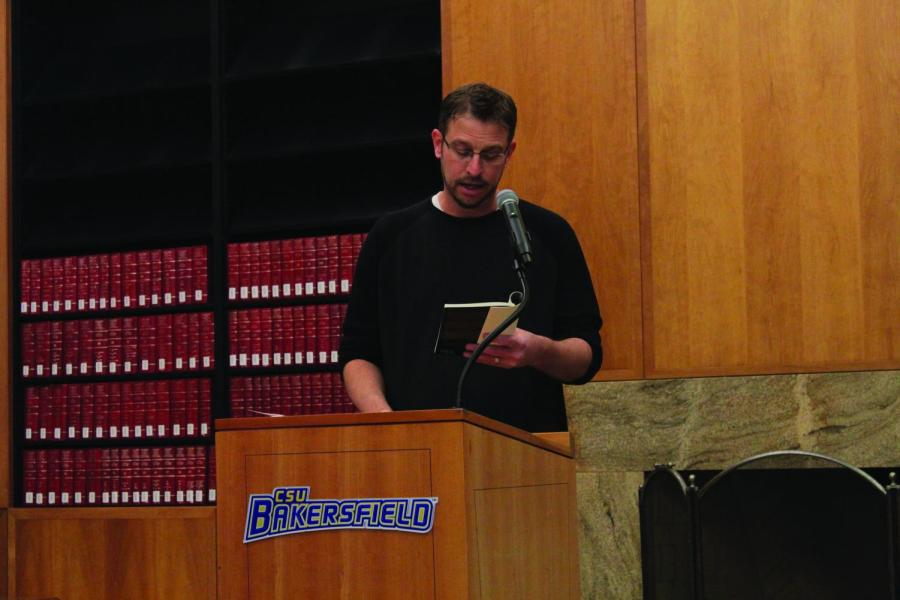 Poet Lindsay Wilson reciting a poem on October 14 in the Dezember room in the Walter W. Stiern Library part of the California Writers Series.