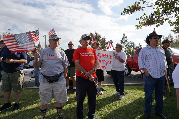 Community members gather to show their support for the current president at a pro Trump rally organized by Luther Craig on California Ave. Thursday Oct. 15