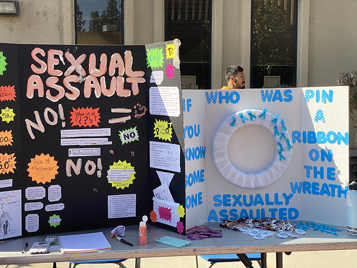 Valeria Padilla and Jennifer Cano (not pictured) presented a poster with the Sexual Assault topic. A wreath was also on their booth for students to place a pin if they knew/know someone who's been a victim of sexual assault.