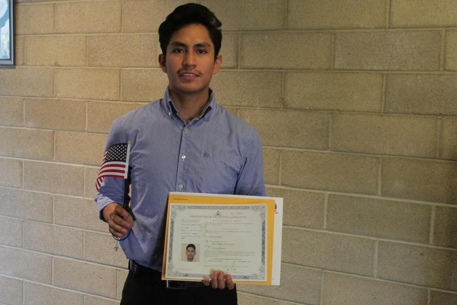 Former CSUB student, Israel Cardenas, poses with his certificate of citizenship after the Naturalization Ceremony inside the Dore Theatre on Nov. 12, 2019.