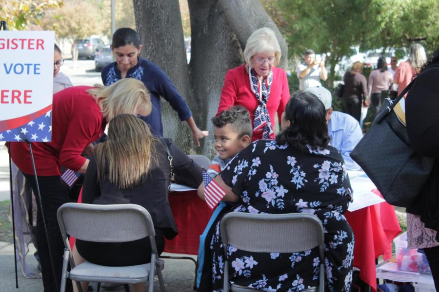 Newly naturalized citizens register to vote after the Naturalization Ceremony in the Dore Theatre on Nov. 12, 2019.