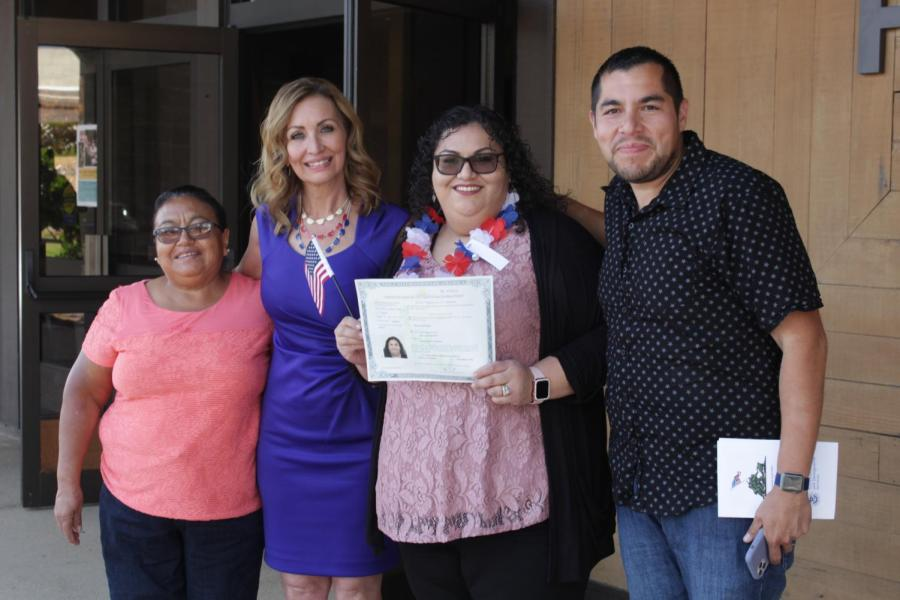 Valley citizen Alma Fuentes along with her family pose proudly with her certificate of citizenship after the naturalization ceremony in the Dore Theatre on Nov. 12, 2019.