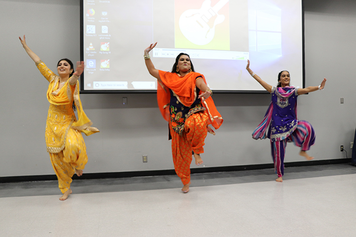 From left: Henna Singh, Yaddeep Kaur Gill, and Jasleen Mander preform a Bhangra dance, a Punjabi folk dance. The Bhangra dance is done at every occasion of happiness, such as weddings, birthdays, and festivals. Henna, Kaur, and Jasleen are all wearing Salwar Kameez suits.