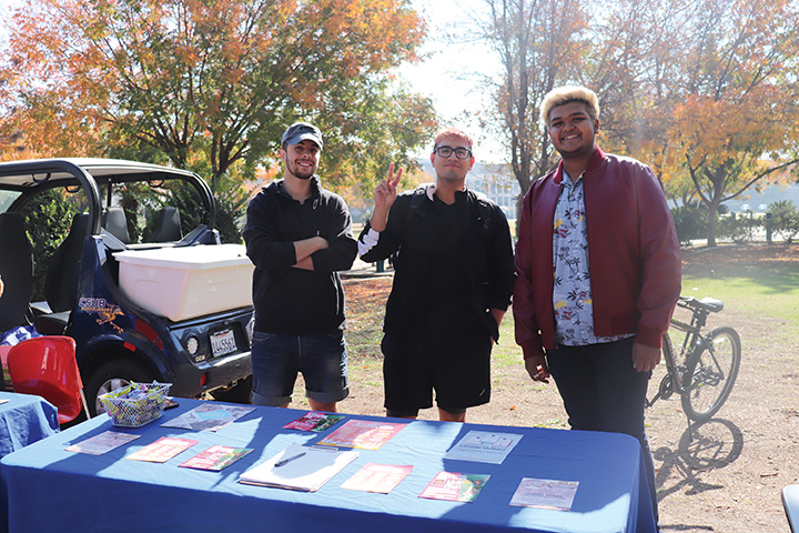 From left: Loay Samha, Ramon Llamas, and Divyang Motavar, tabled outside near the SU Patio with information about international clubs, programs, and resources on campus on Nov. 18, 2019.