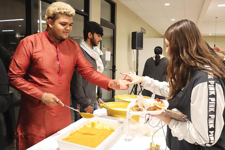 International student from India, Divyang Motavar, was serving Indian food for CSUB students at Runner Café on Nov. 20, 2019.