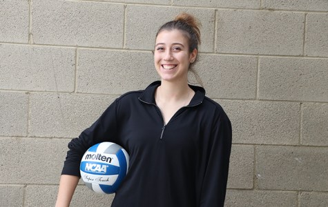 Volleyball player, Milica Vukobrat, poses with a volleyball outside of the old gymnasium on Nov. 13, 2019.
