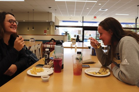 Students eating in the Runner Cafe during the Fall 2019 semester. Runner Cafe is one of many dining options available on campus.
