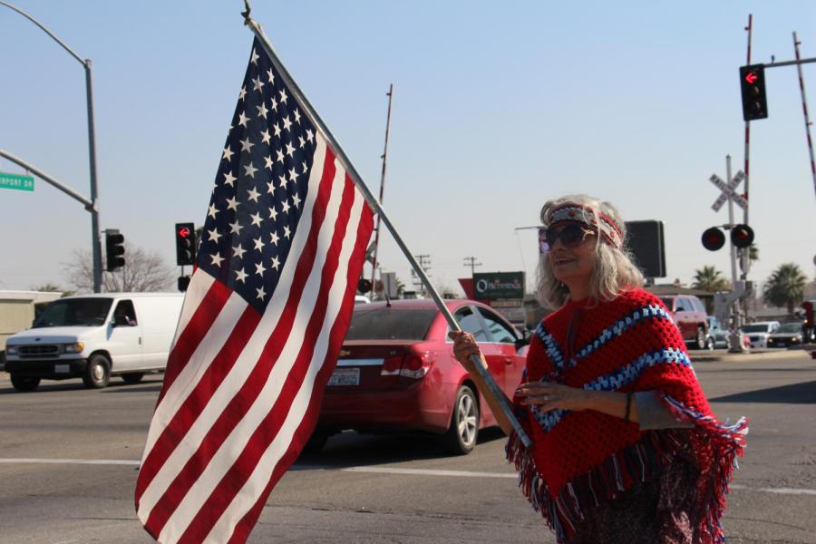 Tina Sickle holds her U.S. flag with pride to show her support of President Trump's arrival at Meadows Field Airport on Feb. 19.