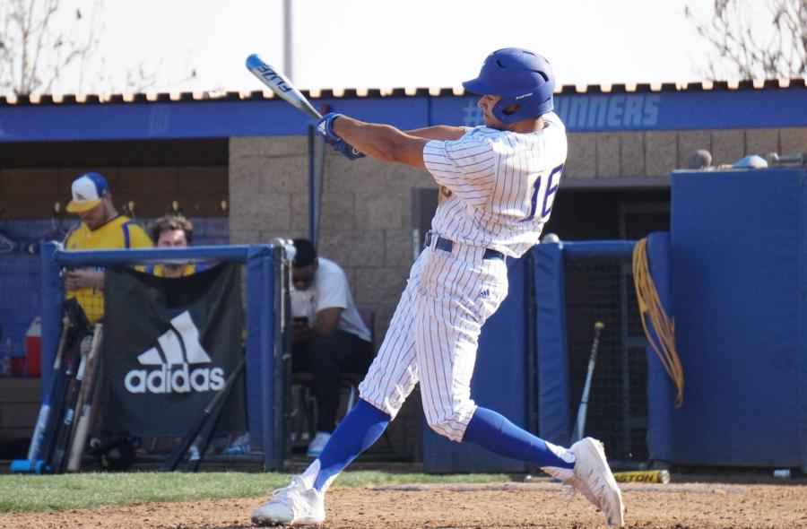 CSUB+redshirt+freshman+Jacen+Roberson+takes+a+swing+at+the+Alumni+Game+on+Feb.+1+at+Hardt+Field.
