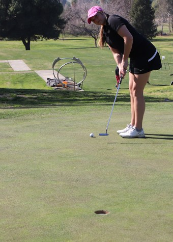 Senior Brandi Borjon practices putting at the Rio Bravo Country Club on Feb. 14.