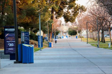 A student walks by the Student Health Center on the way to parking lot on the south side of campus on March 10, 2021
