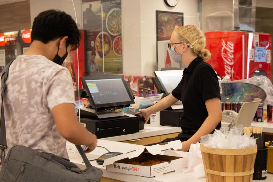 CSU, Bakersfield Runner Café employee, Nancy Smith, helps student purchase pizza. Wednesday, September 1, 2021.