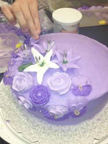 Anastasia decorating cake