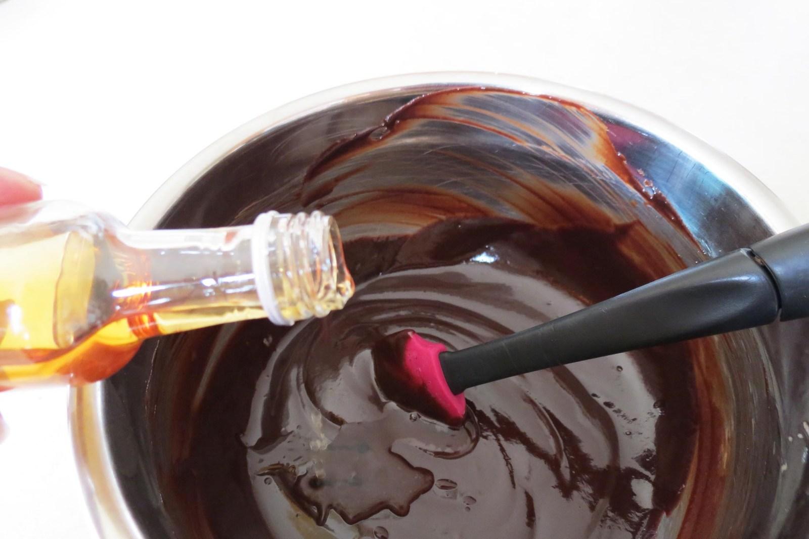 adding-brandy-to-ganache