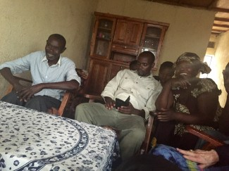 Joseph's father (far left) and mother (far right) tell us welcome us into their home