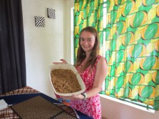 Kelly models with her masterpiece: an apple crisp!