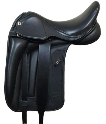 Dante Vinici - Whether dressage, jump, or GP, the new Dante line from Black Country features a narrower twist and forward balance to really put the rider as close as possible to the center of the horse's balance and in the most optimal position. Stylistically, the Dante is set apart by its squared off cantle, flaps, and skirt. Even the head nail is square adding to the unique appearance of this saddle! The Dante Vinici further enhances closeness of rider to horse with the monoflap design - a single layer of leather between horse's barrel and rider's leg enables you to communicate most subtly. The medium-deep seat and knee roll configuration offer non-restrictive security and support for the correct posture. Those who haven't sat in a Vinici worry that they will feel the girth straps under their thigh, but years of rider feedback assure you will not! The Dante is also available in a dual flap if you prefer a more traditional look. Calf-covered leather is the luxurious standard for this beautiful saddle.