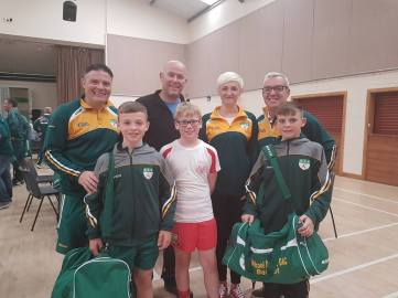 Davitt's players and mentors with their hosts at Tyholland
