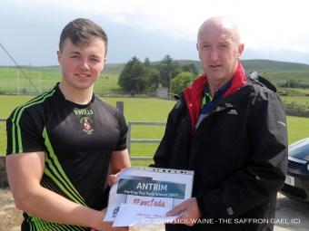 Dominic McKinley presents the winners prize to Donal McKernan