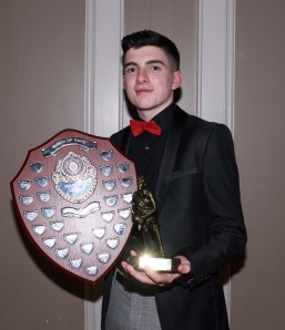Corey Fogerty lifts the U16 player of the year award.