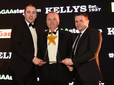Hall of Fame award presented to Andy McCallin, by Niall McCoy, Gaelic Life, and Ciaran Woods, the GAAstore. MC 71