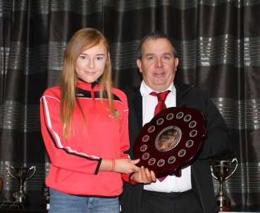 Eimear McGivern with the Jim Nelson Shield