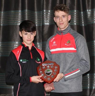 NA Feile Skills winner Ronan McCollum with James McNaughton