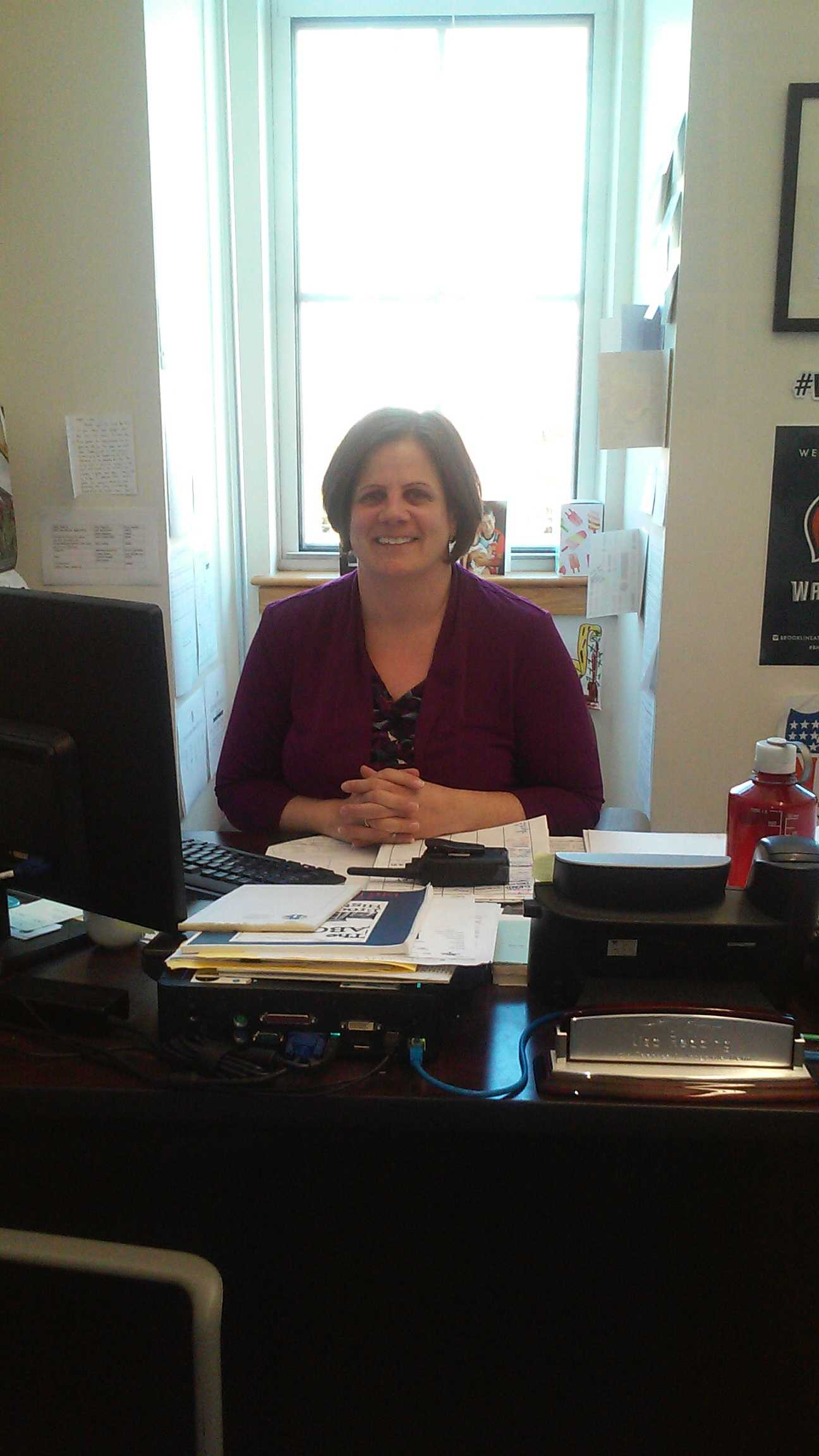 Associate Dean Lisa Redding is pictured in her office. In addition to being  a dean, Redding also teaches a math class at the high school.