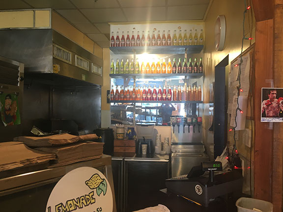 A+wall+of+Jarritos%2C+a+popular+Mexican+soda%2C+is+on+display+behind+the+counter+at+Baja+Betty%27s.+ETHAN+GAINSBORO+%2F+SAGAMORE+STAFF