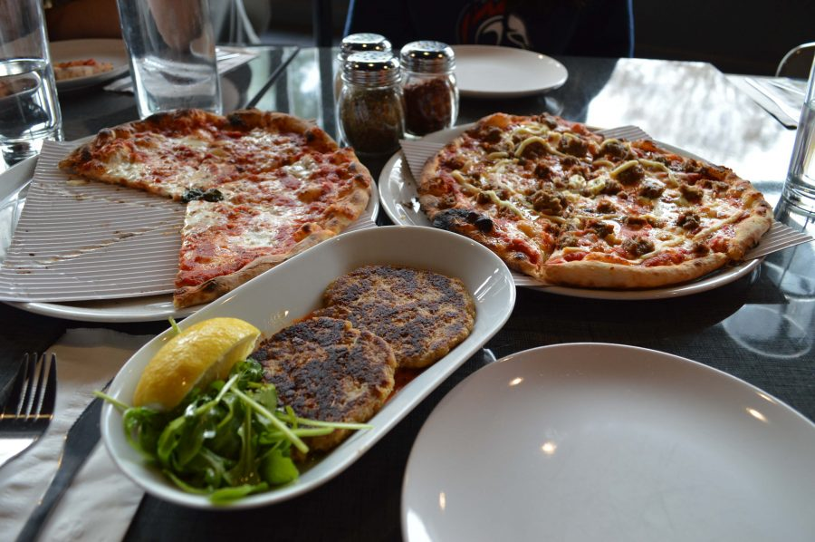 The classic cheese pizza, $12.00 (left), cauliflower fritters, $8.00 (center) and Meatball and Ricotta, $16.00 (right) were exciting additions to our Stoked order. Sara Hogenboom / Sagamore Staff