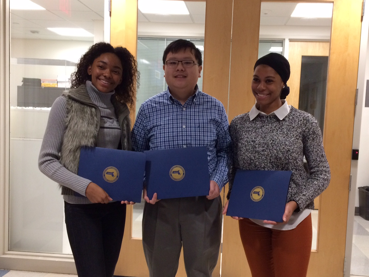 Seniors and MASS award recipients Carolyn Parker-Fairbain, Evan Yu and Tiara Ranson pose together with their awards.