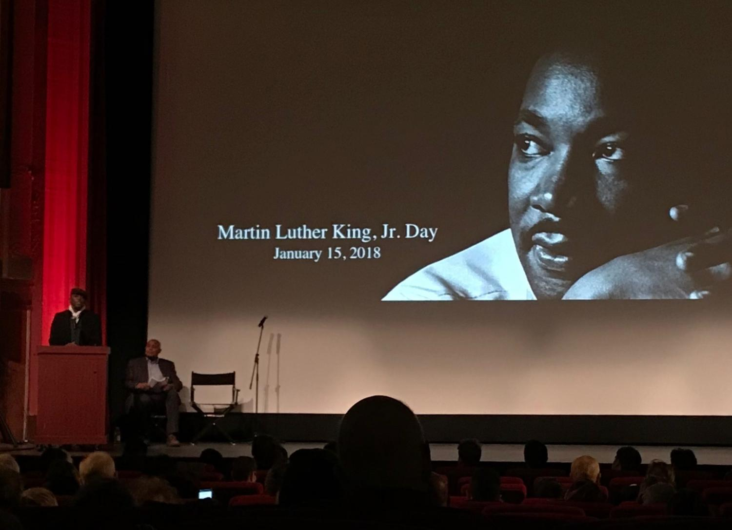 The iconic photo of Dr. King presides over the Coolidge Corner Theater as speakers prepare their remarks. NATALIE JEW/SAGAMORE STAFF
