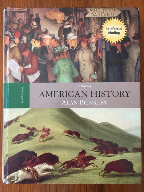 Students take notes on Alan Brinkley's textbook