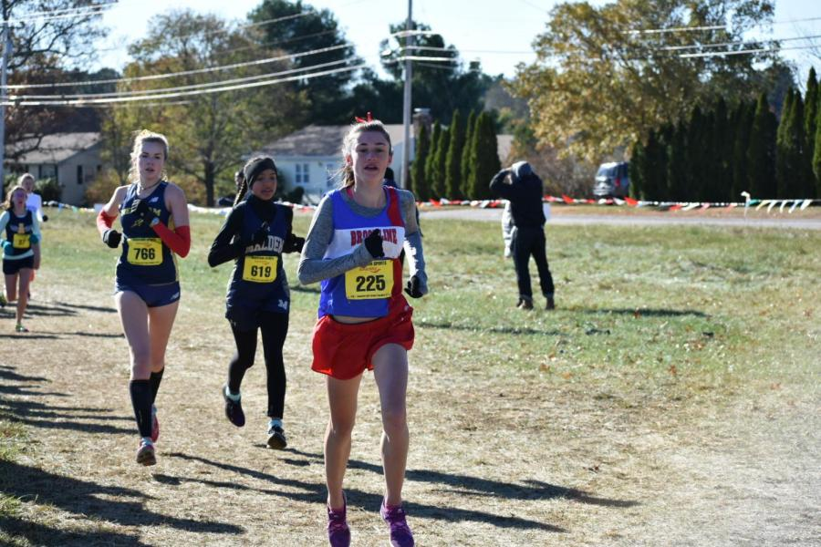 Freshman+Vivian+McMahon+runs+at+the+Eastern+Massachusetts+Division+1+Championship+on+Nov+11.+According+to+McMahon%2C+the+greatest+part+of+running+at+the+high+school+is+the+people.+