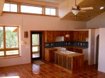 Custom kitchen cabinetry with door leading to the screened porch.