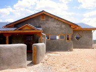 """An early off grid straw bale """"spec"""" house."""