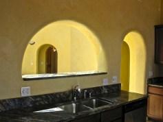 Kitchen sink looking through archway into the Atrium.