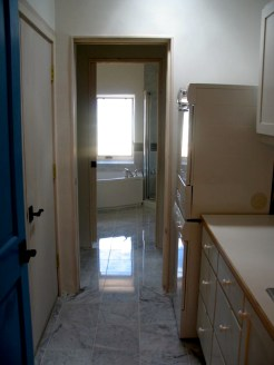 White marble floor from Laundry room into Master Bathroom.