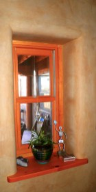 Plastered window in Straw Bale wall with a Douglas FIr sill.